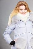 Woman wearing winter warm furry jacket Stock Photography