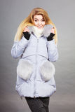 Woman wearing winter warm furry jacket Royalty Free Stock Images