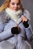 Woman wearing winter warm furry jacket Royalty Free Stock Image