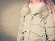 Woman wearing winter warm furry jacket Stock Images