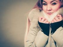 Woman wearing winter warm furry jacket Stock Photo