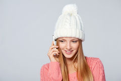 Woman wearing woolen hat and sweater Stock Photos