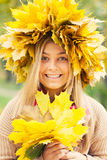 Woman wearing a wreath of autumn leaves Stock Photo