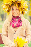 Woman wearing a wreath of autumn leaves Stock Image