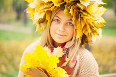 Woman wearing a wreath of autumn leaves Royalty Free Stock Photo