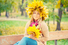 Woman wearing a wreath of autumn leaves Stock Images