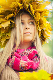 Woman wearing a wreath of autumn leaves Royalty Free Stock Photography