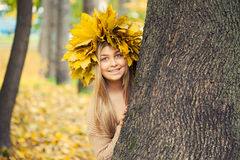 Woman wearing a wreath of autumn leaves Stock Photos