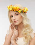 Woman wearing wreath of flowers Stock Photography