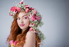 Woman with wearing a wreath of tulips Royalty Free Stock Photos