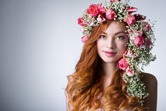Woman with wearing a wreath of tulips Stock Image