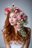 Woman with wearing a wreath of tulips Stock Photography