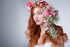 Woman with wearing a wreath of tulips Royalty Free Stock Image