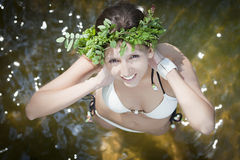 Woman wearing a wreath of wild flowers Stock Photo