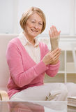 Woman wearing wrist stabilizer bandage on arm Stock Photo