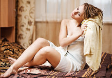 Woman wearing yellow bath towel Royalty Free Stock Image