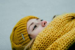 Woman Wearing Yellow Crochet Cap and Scarf Royalty Free Stock Photos