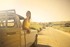 Woman Wearing Yellow Shirt Inside Pickup Truck Royalty Free Stock Photo