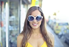 Woman Wearing Yellow Spaghetti Strap Top and Round Sunglasses Royalty Free Stock Images