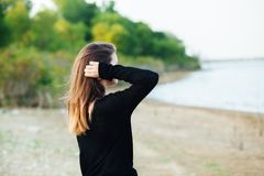 Woman Wears Black Long-sleeved Shirt Standing Near Body of Water royalty free stock photography