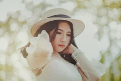 Woman Wears White Dress and Brown Hat Royalty Free Stock Photography