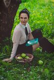 Woman Weasring White Dress Shirt Sitting in Green Grass Under Brown Large Tree Royalty Free Stock Photos