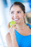 Woman weating an apple Stock Photo