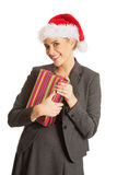 Woman weating Santa hat and holding a present Royalty Free Stock Images