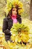 Woman weaves a wreath. Beautiful woman weaves a wreath of leaves royalty free stock photography