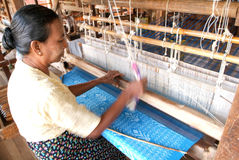 Woman weaving a carpet with a loom at lake Inle on Myanmar Royalty Free Stock Photo