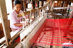 Woman weaving a carpet with a loom at lake Inle on Myanmar Stock Images