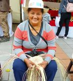 Woman weaving ecuadorian Panama Hat or Straw Hats, Ecuador. Cuenca, Ecuador - March 8, 2019: Woman demonstrates weaving of Panama Hat or Paja Toquilla Hat at stock images
