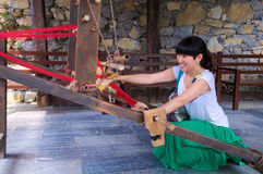 Woman Weaving at a Loom Stock Images