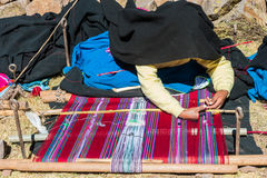 Woman weaving in the peruvian Andes at Puno Peru Stock Image