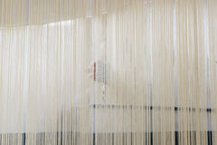 Woman weaving a rug royalty free stock photo