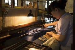 Woman weaving silk brocade Stock Photos
