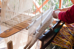 Woman weaving silk at manual loom. Laos Royalty Free Stock Photos