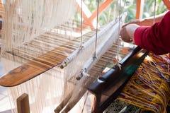 Woman weaving silk at manual loom. Laos Royalty Free Stock Photos