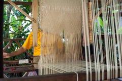 Woman weaving silk at manual loom. Laos Stock Photography