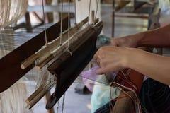 Woman weaving silk at manual loom. Laos Royalty Free Stock Photography