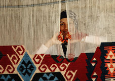 Woman weaving a traditional Turkish carpet stock image