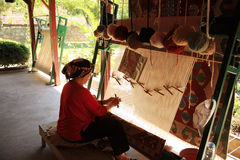 Woman weaving a Turkish rug Stock Photo