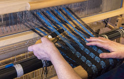 Woman Weaving Using a Boat Shuttle Royalty Free Stock Images