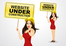 Woman and website under construction message Royalty Free Stock Photography