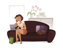 Woman websurfing. Cute young woman working on laptop and using a cellphone while resting in her home Royalty Free Stock Image