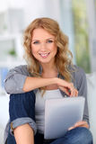 Woman websurfing at home Royalty Free Stock Photo