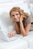 Woman websurfing at home Stock Images