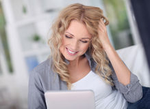 Woman websurfing on internet Stock Photos