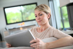Woman websurfing on tablet Stock Photography