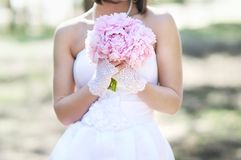 Woman with wedding bouquet Stock Images